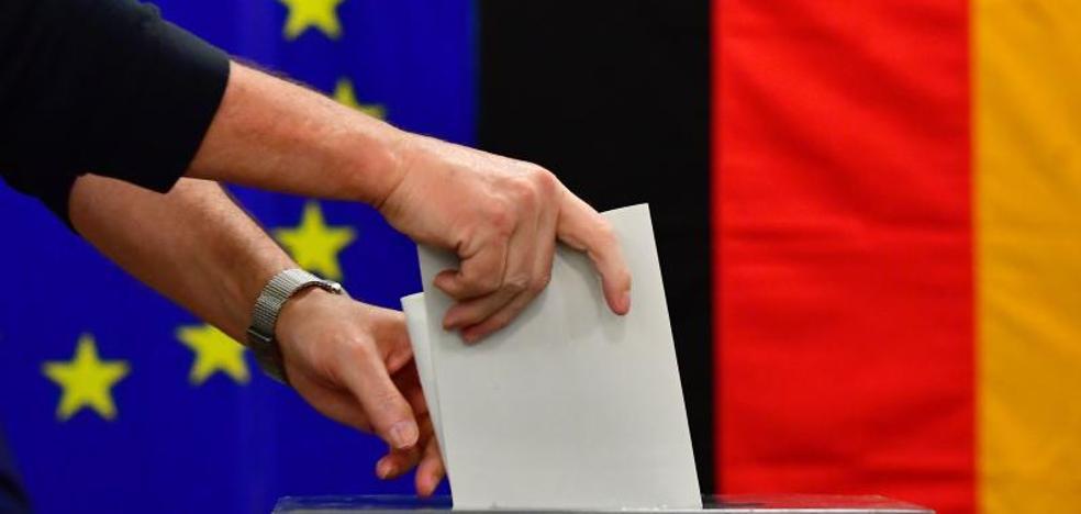 Merkel gana con los sondeos a pie de urna mientras la ultraderecha se convierte en tercera fuerza