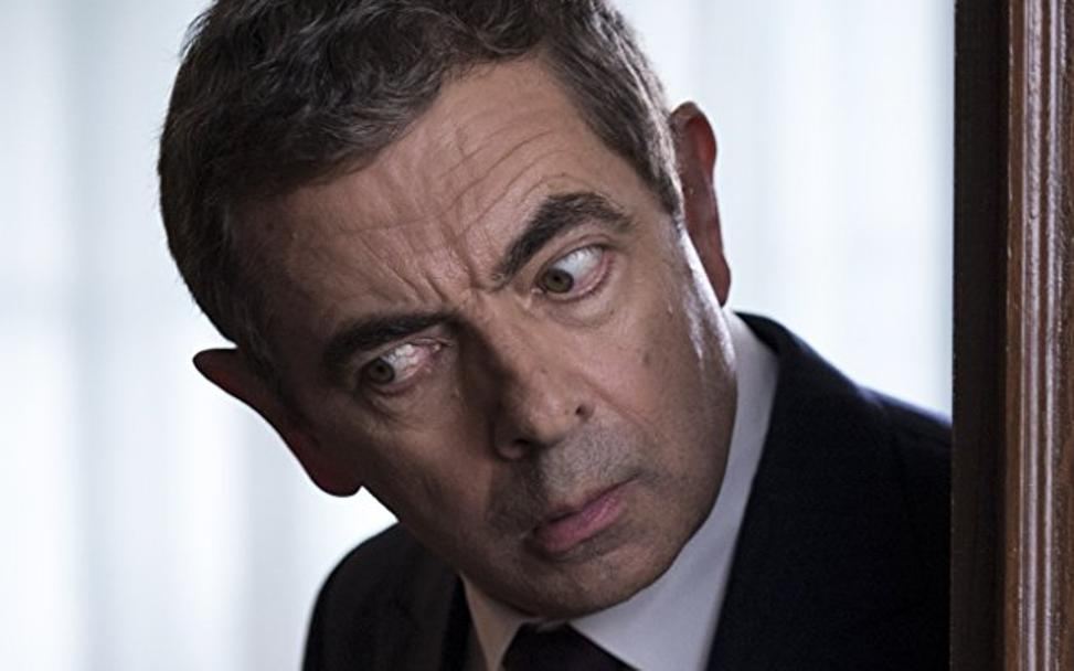 Rowan Atkinson se mete nuevamente en la piel de Johnny English (2018)./
