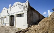 Las obras en las naves de Gamazo desnudan los muros y cerchas de la edificación que acogerá la sede de Enaire