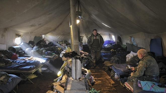 Al menos 18 civiles muertos horas antes del alto el fuego en Ucrania