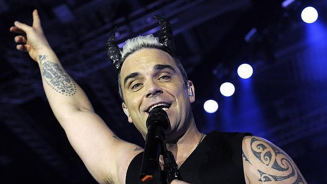 Robbie Williams le pide una cita a Máxima de Holanda para tomar café